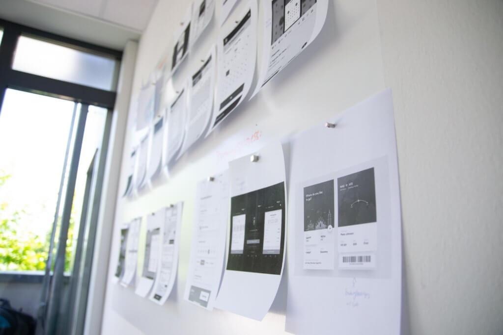 design mockups on whiteboard wall